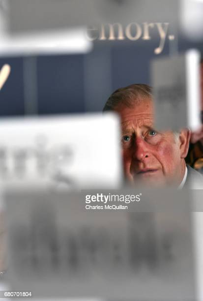 Prince Charles Prince of Wales peers through a display of words used by the late Seamus Heaney as he visits the Seamus Heaney Home Place on May 9...