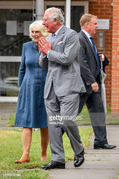Prince Charles, Prince of Wales performs a namaste as he arrives with Camilla, Duchess of Cornwall at Gloucestershire Royal Hospital as they meet...