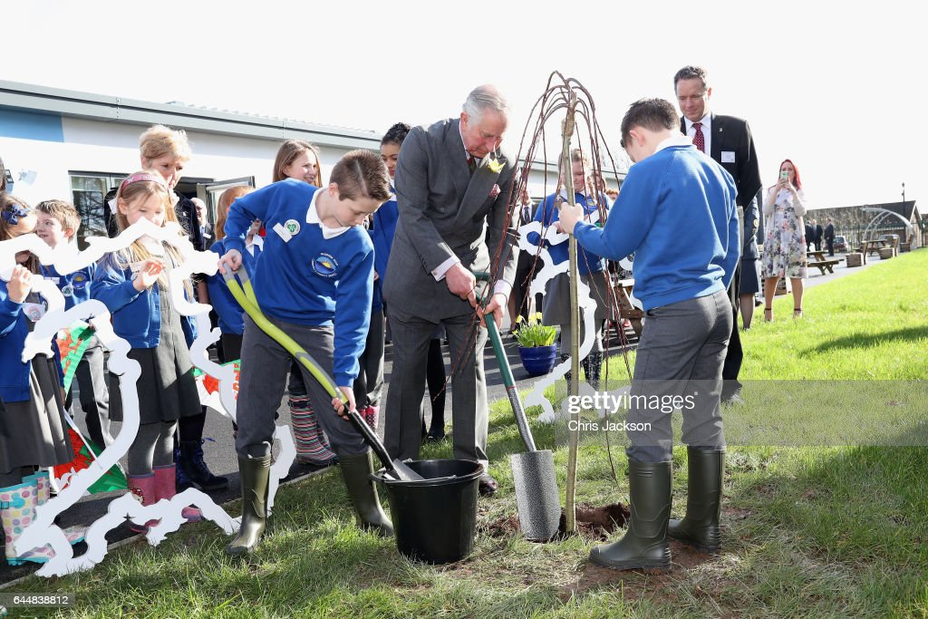 Prince Charles, Prince of Wales plants a tree with pupils and teachers involved in a climate change education programme run by the charity, Size of Wales, at Blenheim Road Community Primary, on February 24, 2017 in Cwmbran, United Kingdom.