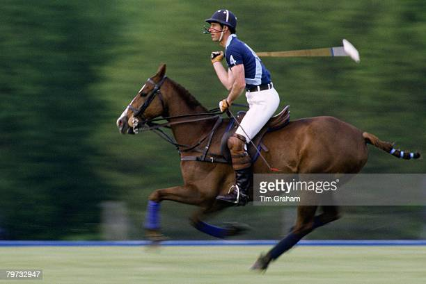 Prince Charles, Prince of Wales playing polo