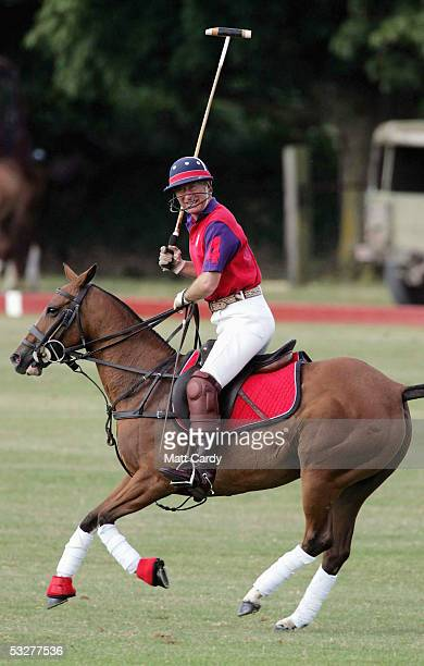 Prince Charles Prince of Wales plays polo for the Highgrove Polo Team in the charity polo day in aid of the Royal Agricultural Benevolent...