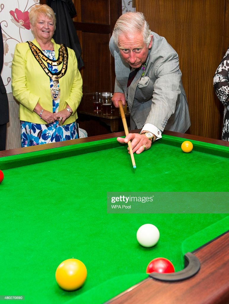 Prince Charles, Prince of Wales plays snooker during a visit to the Glan yr Afon Arms, which is supported by The Prince's Pub is the Hub initiative on July 10, 2015 in Talgarreg, Wales.