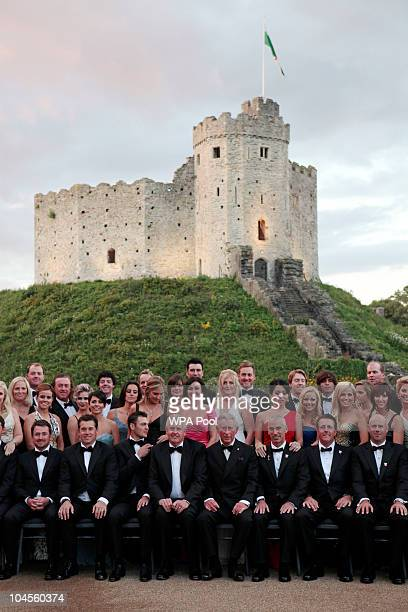 Prince Charles Prince of Wales poses for a photo with the European and American Ryder Cup teams as they attend the 2010 Ryder Cup Dinner at Cardiff...