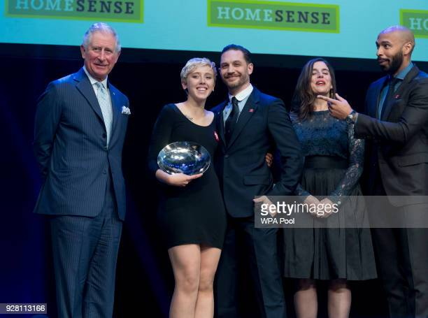Prince Charles Prince of Wales poses for a photograph with Homesense Young Achiever of the Year winner Daisy McDonnell and Tom Hardy at The Prince's...