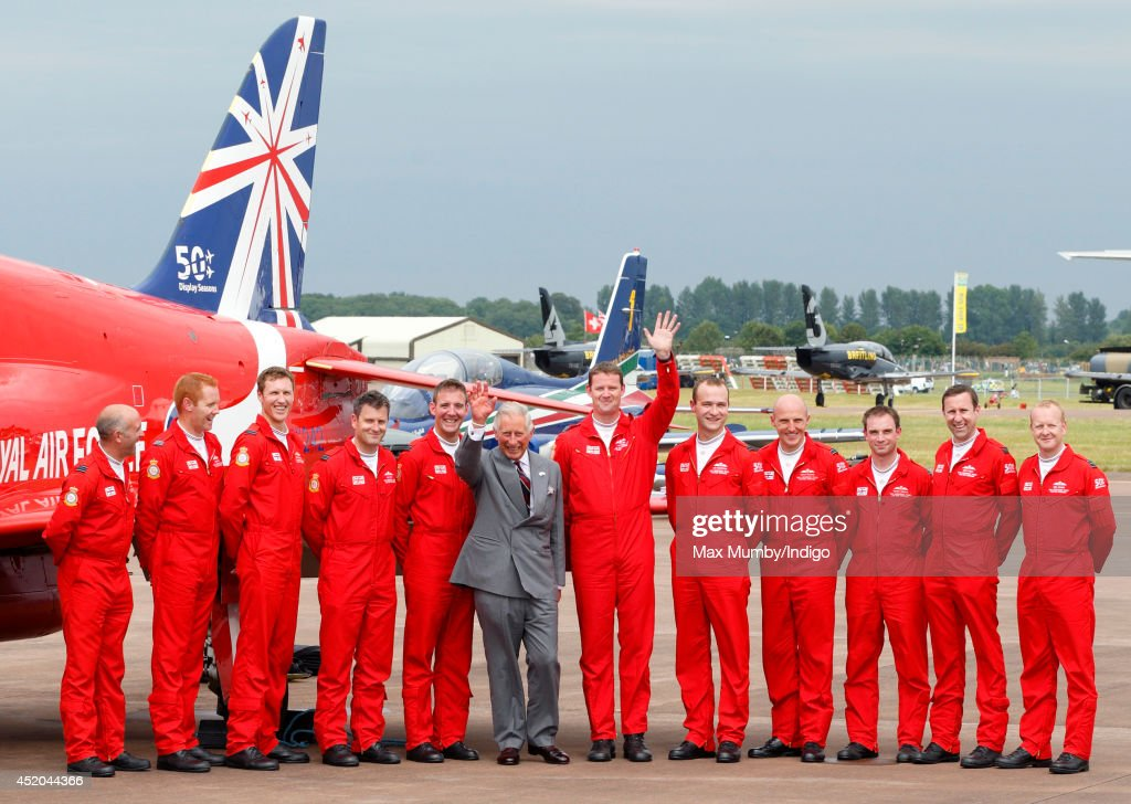 Prince Charles, Prince of Wales poses for a photograph with pilots of the RAF Aerobatic Team, The Red Arrows as he visits the Royal International Air Tattoo at RAF Fairford on July 11, 2014 in Fairford, England.