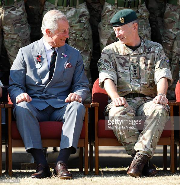 Prince Charles Prince of Wales poses for a regimental photograph as he visits 2nd Battalion The Royal Gurkha Rifles at Sir John Moore Barracks on...