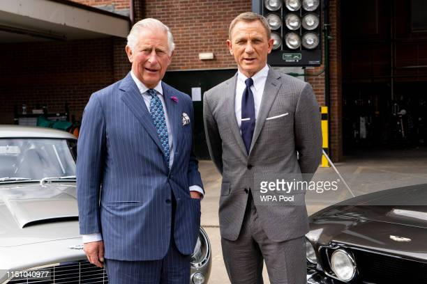 Prince Charles, Prince of Wales poses with British actor Daniel Craig as he tours the set of the 25th James Bond Film at Pinewood Studios on June 20,...