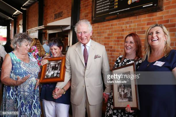 Prince Charles Prince of Wales poses with guests after particpating in a tour of the Bundaberg Rum Distillery on April 6 2018 in Bundaberg Australia...
