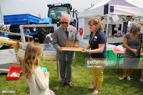 Prince Charles Prince of Wales presents Delilah Cresswell winner of the selfie frame competition that will link 6 of the show's educational videos...