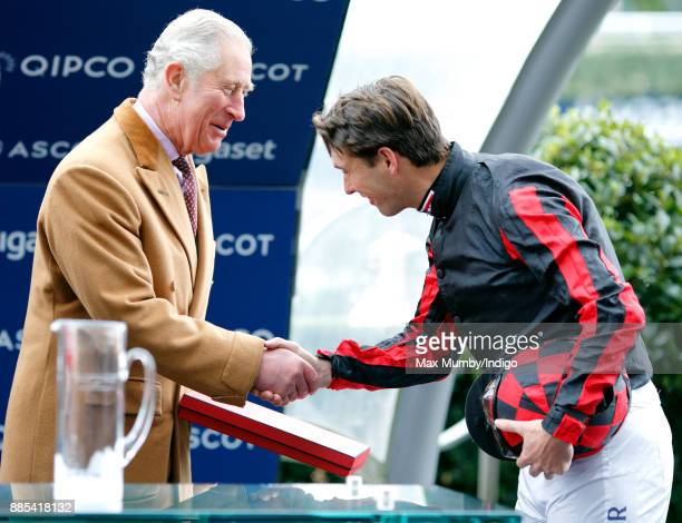 Prince Charles Prince of Wales presents Harry Meade with his prize for taking part in the The Prince's Countryside Fund Charity Race at Ascot...