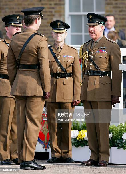 Prince Charles Prince of Wales presents leeks to mark St David's Day to soldiers of the 1st Battalion The Welsh Guards at Cavalry Barracks on March 1...