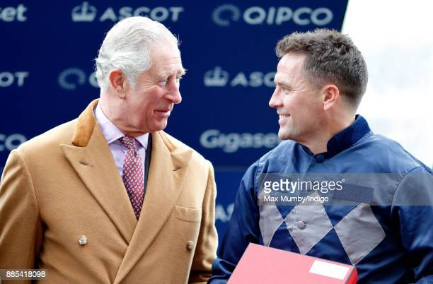 Prince Charles Prince of Wales presents Michael Owen with his prize for coming second in the The Prince's Countryside Fund Charity Race at Ascot...