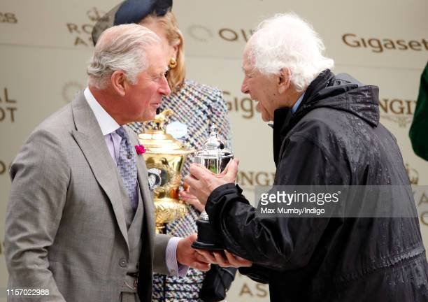 Prince Charles, Prince of Wales presents Sir Evelyn de Rothschild with his trophy after winning The Prince of Wales Stakes on day two of Royal Ascot...