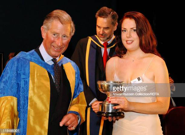 HRH Prince Charles Prince of Wales presents soprano Anna Leese with the Queen Elizabeth The Queen Mother Rose Bowl at a ceremony at the Royal College...