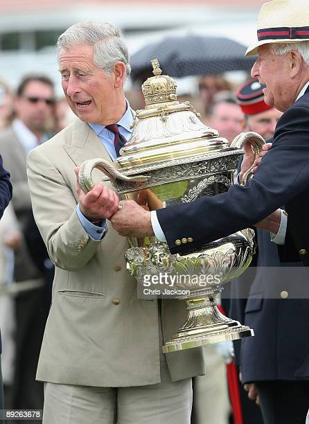 Prince Charles Prince of Wales presents the Coronation Cup to the Captain of the Argentinian Team Adolfo Cambiaso after they beat England during the...