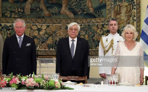 Prince Charles Prince of Wales President of Greece Prokopis Pavlopoulos and Camilla Duchess of Cornwall stand for the anthem during an Official...