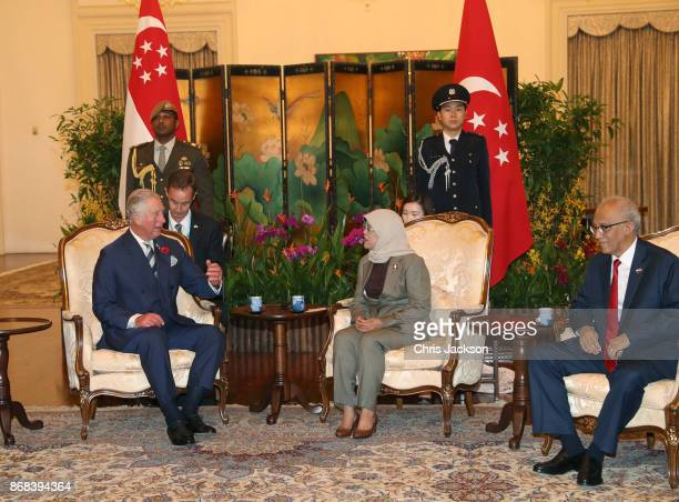 Prince Charles Prince of Wales President of Singapore Halimah Yacob and First Gentleman of Singapore Mohamed Abdullah Alhabshee speak during the...