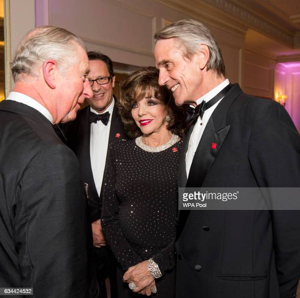 Prince Charles, Prince of Wales, President of The Princes Trust, chats to Joan Collins and Jeremy Irons as he attends the annual Princes Invest In...