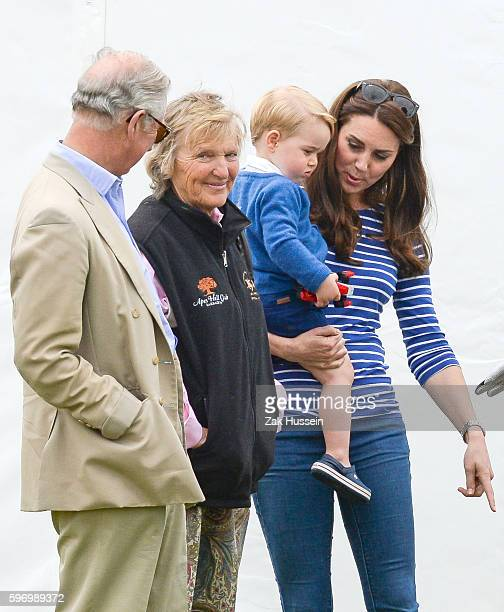 Prince Charles Prince of Wales Prince George holding a toy car and Catherine Duchess of Cambridge attend the Gigaset Charity Polo Match at the...