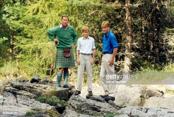 Prince Charles Prince of Wales Prince William and Prince Harry relax together on the banks of the river Dee in the Balmoral Estate on August 16 1997...
