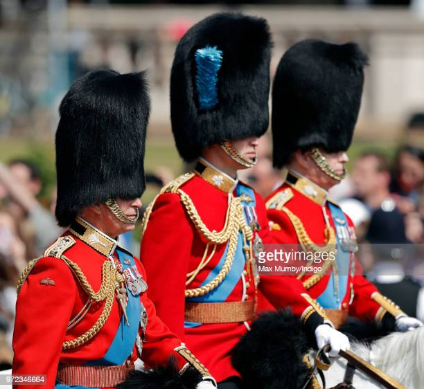 Prince Charles Prince of Wales Prince William Duke of Cambridge and Prince Andrew Duke of York ride on horseback down The Mall during Trooping The...