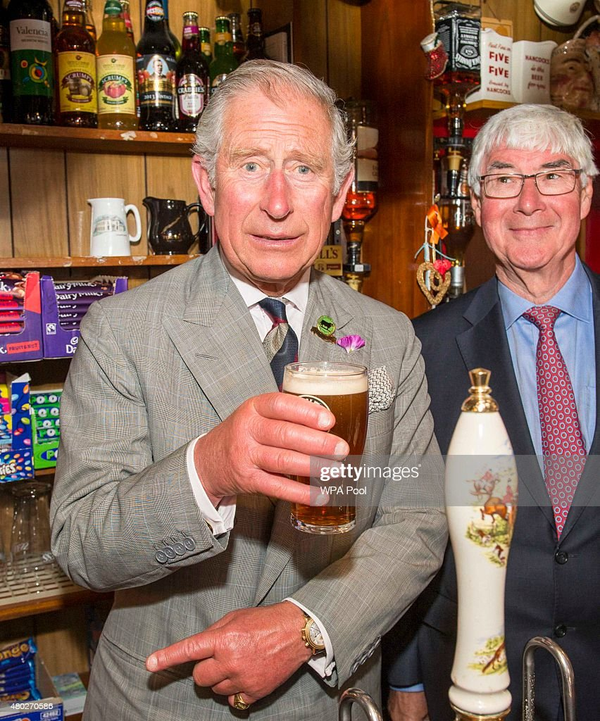 Prince Charles, Prince of Wales pulls a pint during a visit to the Glan yr Afon Arms, which is supported by The Prince's Pub is the Hub initiative on July 10, 2015 in Talgarreg, Wales.