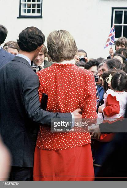 Prince Charles Prince of Wales and Lady Diana Spencer wearing a Jasper Conran suit visit Tetbury on May 221981 in Tetbury England