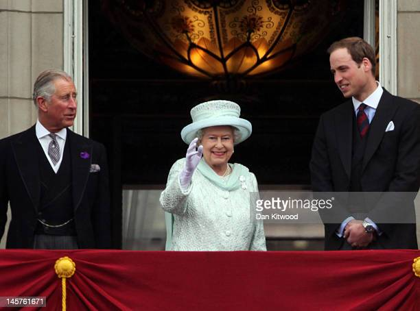 Prince Charles Prince of Wales Queen Elizabeth II and Prince William Duke of Cambridge wave to the crowds from Buckingham Palace during the Diamond...