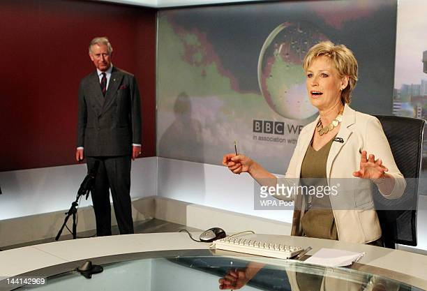 Prince Charles Prince of Wales reads the weather with newsreader Sally Magnusson in the Six O'Clock studio during a tour of the BBC Scotland...