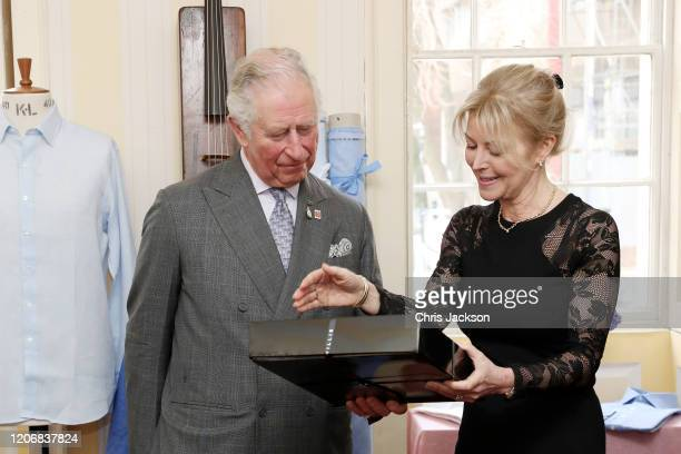Prince Charles Prince of Wales receives a present from Emma Willis during his visit at the Emma Willis LTD factory on February 17 2020 in Gloucester...