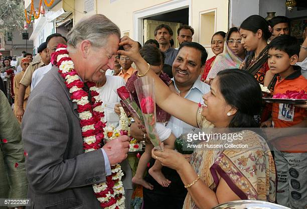 Prince Charles Prince of Wales receives a tilak mark on his forehead as he takes a walking tour of the Old City on the final day of a 12 day official...