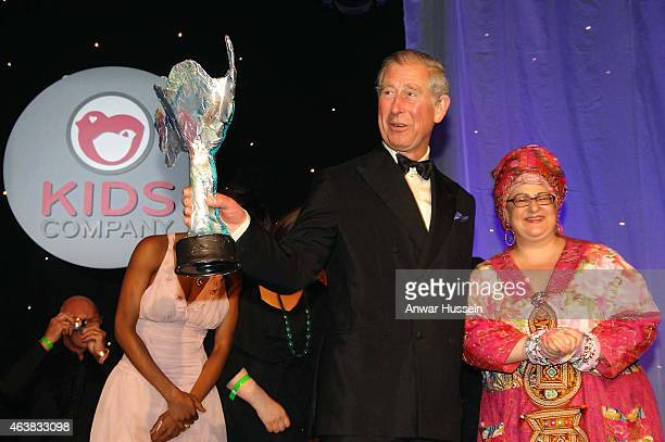 Prince Charles Prince of Wales receives an award from founder Camila Batmanghelidjh at a Kids Company dinner on May 14 2008 in London England