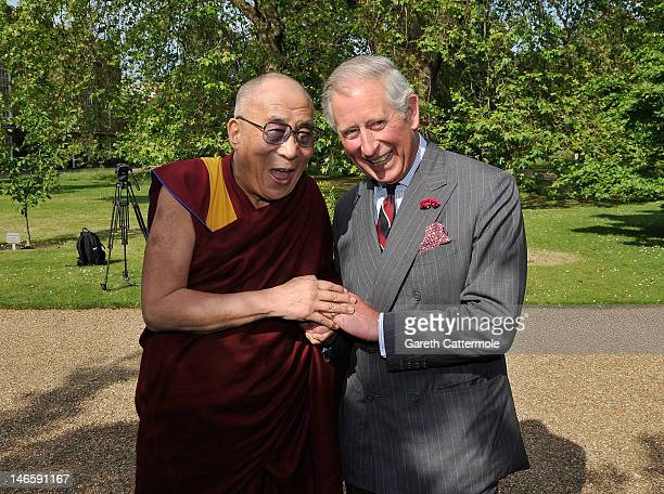 Prince Charles Prince of Wales receives His Holiness the Dalai Lama at Clarence House on June 20 2012 in London England The exiled Buddhist Tibetan...