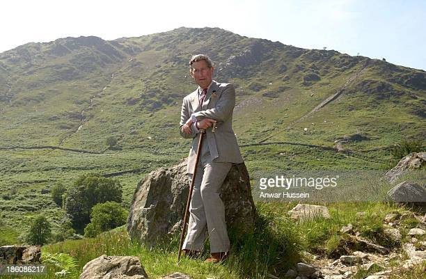 Prince Charles, Prince of Wales relaxes during a visit to the Hafod y Llan estate on Mount Snowdon on July 22, 2000 in Wales.