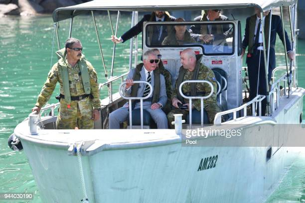 Prince Charles Prince of Wales rides on a naval boat during his visit to the Larrakeyah Defence Precinct on April 10 2018 in Darwin Australia The...
