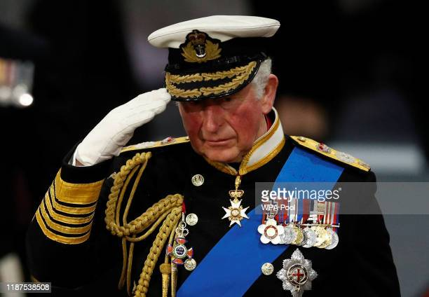Prince Charles Prince of Wales salutes as he attends the official commissioning ceremony of HMS Prince of Wales on December 10 2019 in Portsmouth...