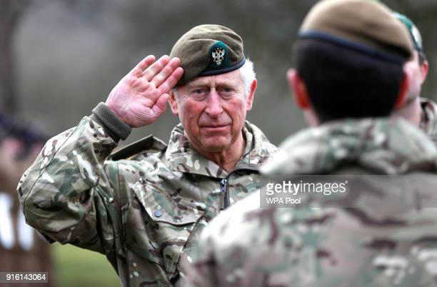 Prince Charles Prince of Wales salutes the troops as he visits 1st Battalion The Mercian Regiment to mark ten years as ColonelinChief and forty years...