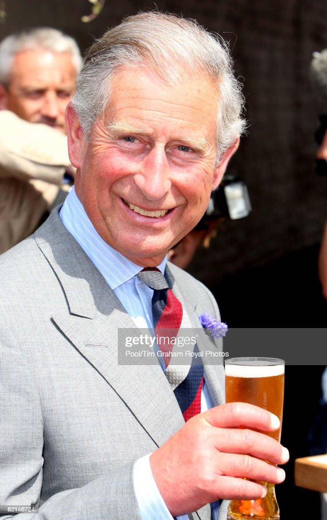 Prince Charles, Prince of Wales samples carbon neutral beer outside The Swan Hotel during a visit to Southwold on July 31, 2008 in Suffolk, England.