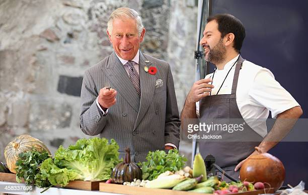 Prince Charles Prince of Wales samples different Mexican food under the guidance of famous Mexican chef Enrique Olvera at the Museo Dolores Olmedo on...