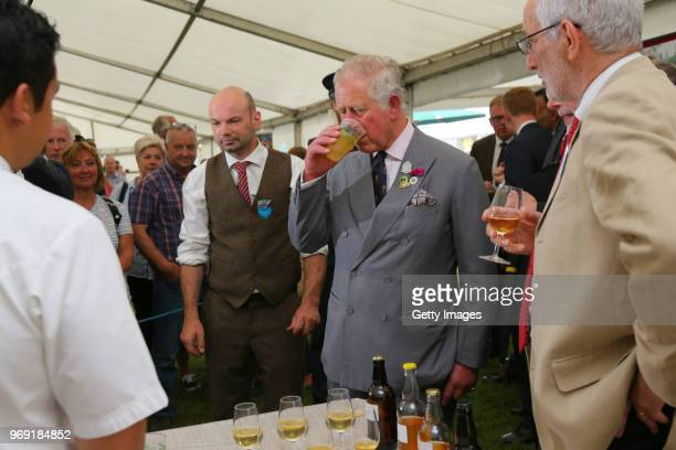 Prince Charles Prince of Wales samples some local produce attends The Royal Cornwall Show at The Royal Cornwall Showground on June 7 2018 in...