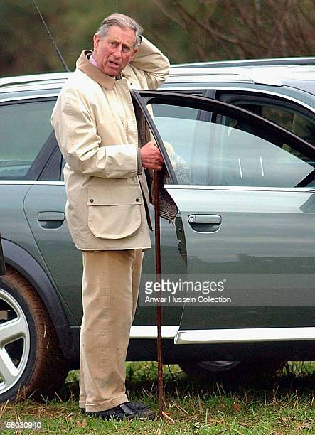 Prince Charles Prince of Wales scratches his head during the National Hedge Laying Championships at Home Farm on October 29 2005 in Tetbury...