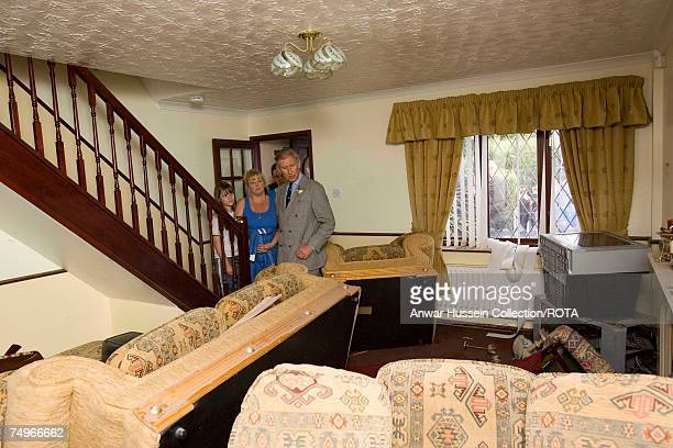 Prince Charles Prince of Wales sees flood damage in the home of the Breeze family during a visit to flood effected areas on June 29 2007 in Catcliffe...