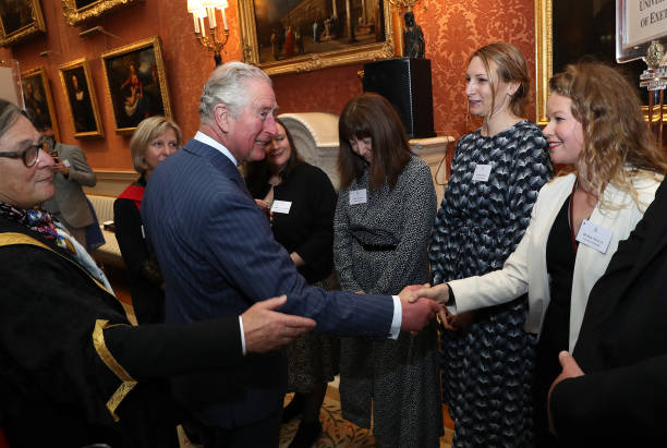 Prince Charles Prince of Wales shakes hands with Dr Emily Duncan of the University of Exeter who won the prize for broadbased research identifying...