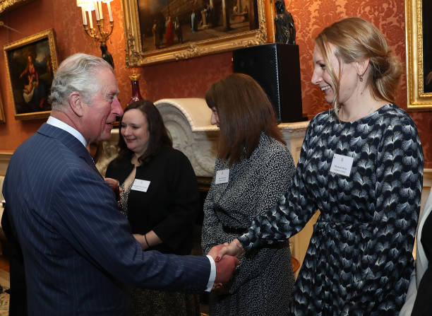 Prince Charles Prince of Wales shakes hands with Dr Sarah Phelms of the University of Exeter who won the prize for broadbased research identifying...