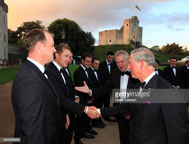 Prince Charles, Prince of Wales shakes hands with Ian Poulter of the European Team during the 2010 Ryder Cup Dinner at Cardiff Castle on September...