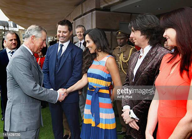 Prince Charles Prince of Wales shakes hands with Myleene Klass as George Clarke Lawrence Llwelyn Bowen and Suzi Perry look on during their visit to...
