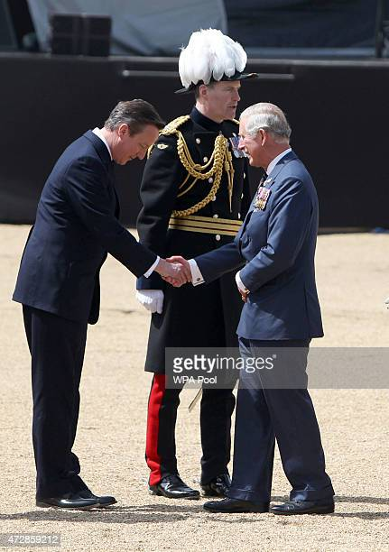 Prince Charles Prince of Wales shakes hands with newly elected Prime Minister David Cameron during the VE Day Parade to mark the 70th anniversary of...