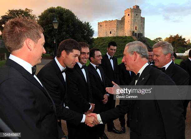 Prince Charles, Prince of Wales shakes hands with Padraig Harrington of the European Team during the 2010 Ryder Cup Dinner at Cardiff Castle on...