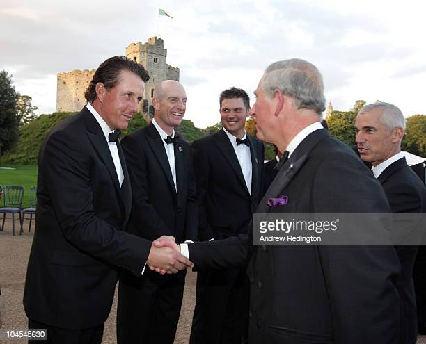 Prince Charles, Prince of Wales shakes hands with Phil Mickelson of the United States Ryder Cup team during the 2010 Ryder Cup Dinner at Cardiff...