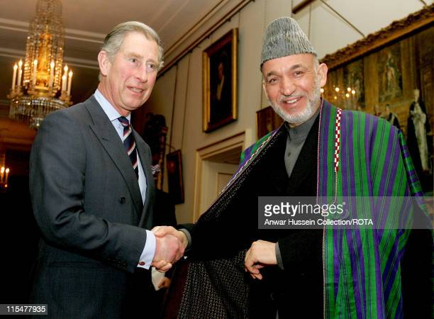 Prince Charles, Prince of Wales shakes hands with President Hamid Karzai of Afghanistan at Clarence House in London on Feb. 14, 2007